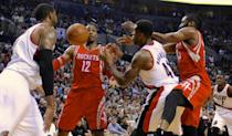 Houston Rockets' Dwight Howard (12) and James Harden (13) battle for a loose ball against Portland Trail Blazers' Thomas Robinson (41) during the first half of game six of an NBA basketball first-round playoff series game in Portland, Ore., Friday May 2, 2014. (AP Photo/Greg Wahl-Stephens)