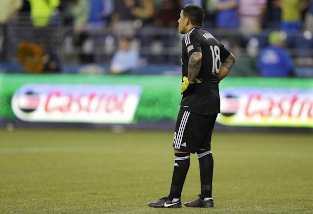Real Salt Lake goalkeeper Nick Rimando stands on the pitch after Seattle Sounders' Obafemi Martins scored an early goal against him in the first half of an MLS soccer match, Friday, Sept. 13, 2013, in Seattle. (AP Photo/Ted S. Warren)