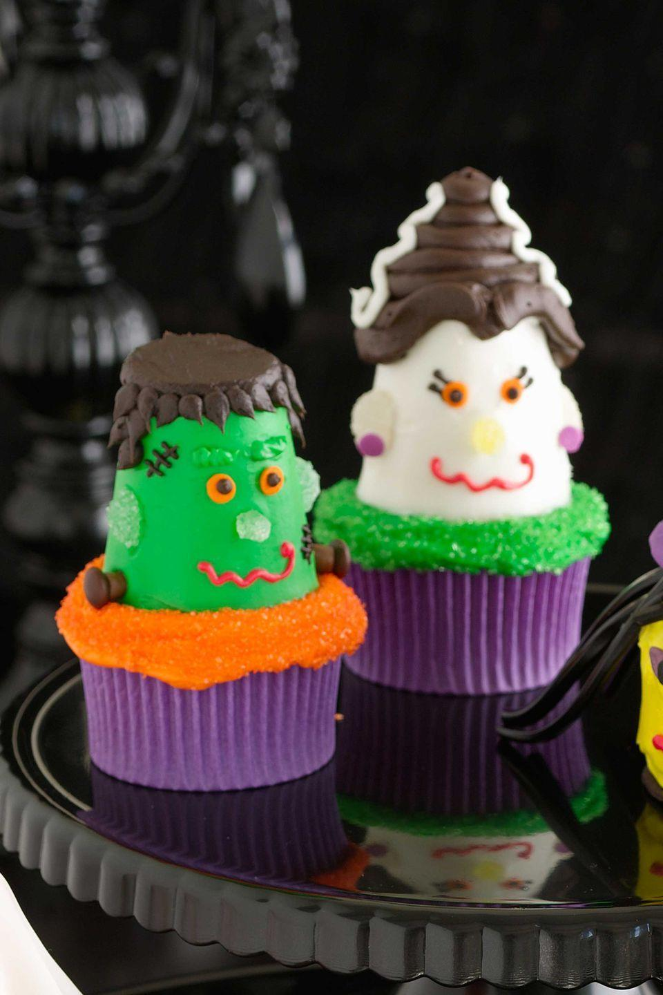 """<p>You'll feel like you just rose from the dead when you bite into this festive cupcake featuring a bright green Frankenstein lookalike, complete with frosting stitches, a gumdrop nose and ears, and Tootsie Roll and M&M bolts. Don't forget to make him a cupcake that resembles his bride.</p><p><a href=""""https://www.womansday.com/food-recipes/food-drinks/recipes/a10783/frankenstein-cupcakes-122189/"""" rel=""""nofollow noopener"""" target=""""_blank"""" data-ylk=""""slk:Get the Frankenstein Cupcakes recipe."""" class=""""link rapid-noclick-resp""""><em>Get the Frankenstein Cupcakes recipe.</em></a></p>"""