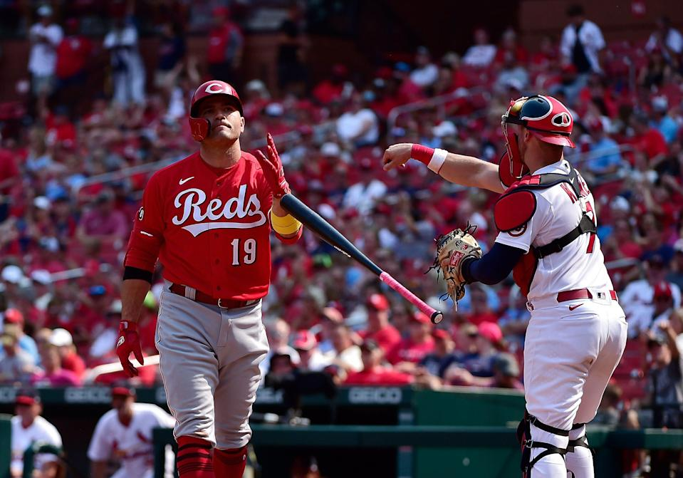 Joey Votto tosses his bat after striking out during a game against the Cardinals.