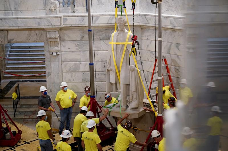 Kentucky Democratic Governor Andy Beshear operates a crane that removes a statue of Confederate President Jefferson Davis from the rotunda of the Capitol Building in Frankfort, Kentucky, U.S. June 13, 2020. (Bryan Woolston/Reuters)