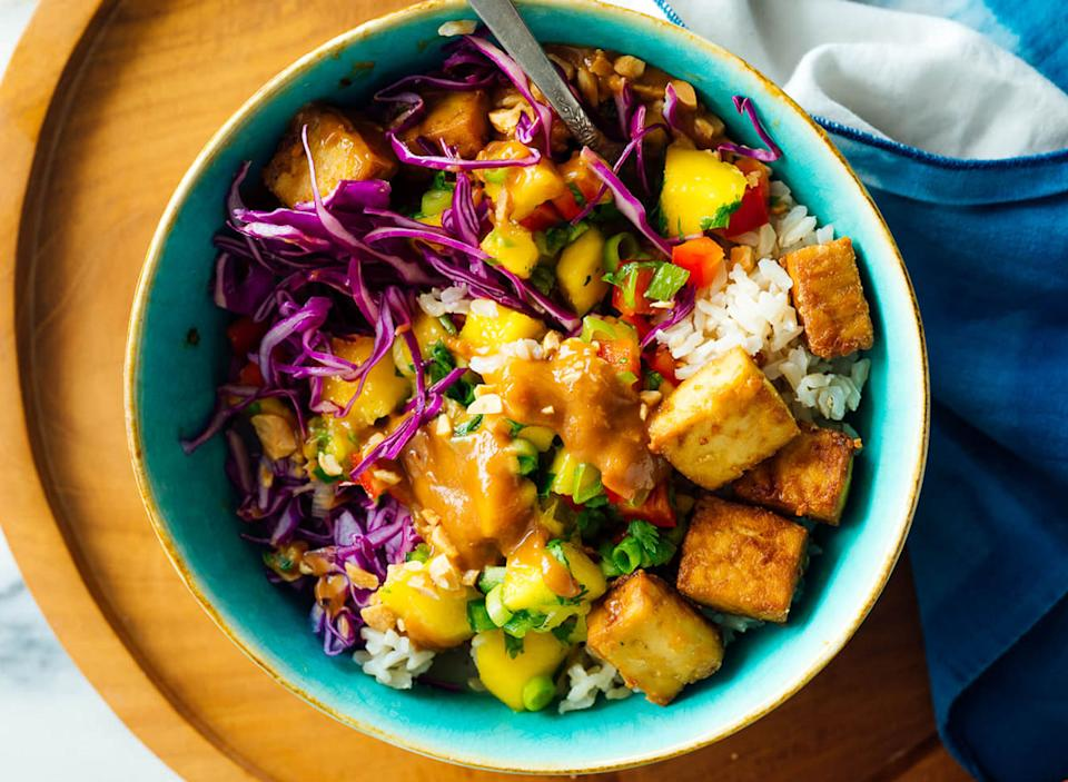 mango burrito bowl on wooden serving board