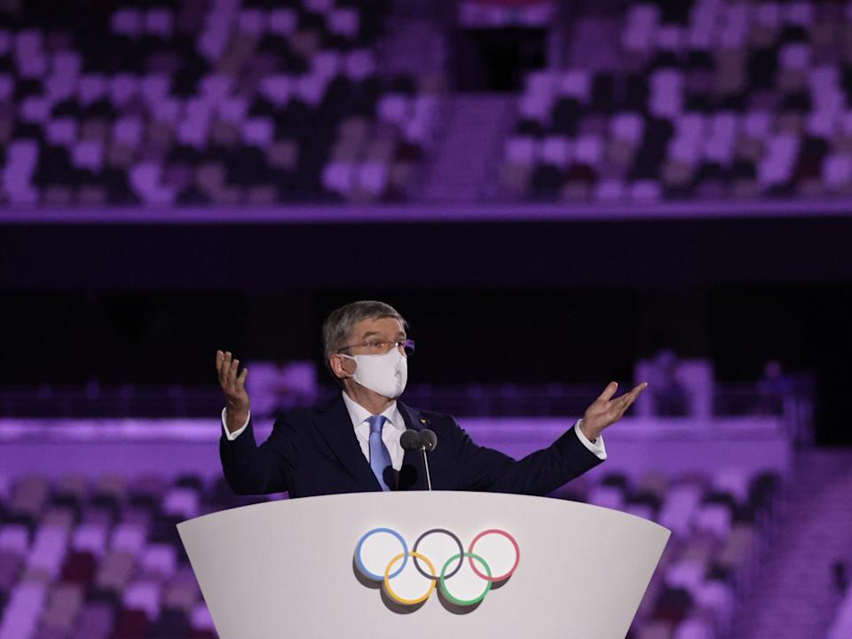 International Olympic Committee (IOC) President Thomas Bach wearing a protective face mask speaks during the opening ceremony. (REUTERS)