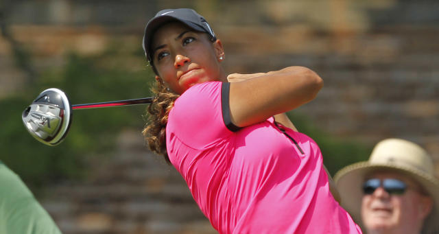 Cheyenne Woods hits her tee shot on the 15th tee during the first round of the U.S. Women's Open golf tournament, Thursday, July 5, 2012, in Kohler, Wis. (AP Photo/Jeffrey Phelps)