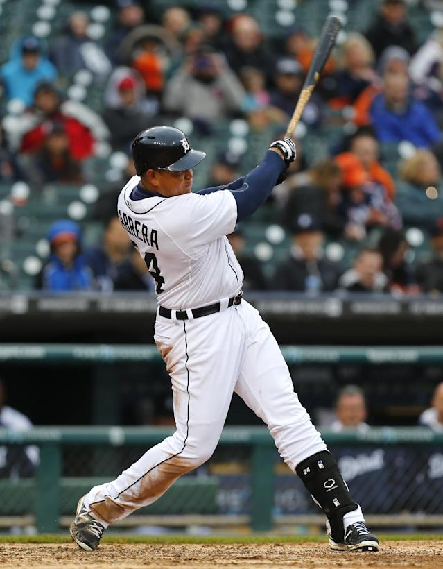 Detroit Tigers' Miguel Cabrera hits a two-run home run against the Baltimore Orioles in the eighth inning of a baseball game in Detroit Friday, April 4, 2014. (AP Photo/Paul Sancya)