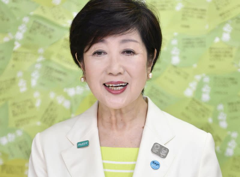 Tokyo governor Yuriko Koike speaks to the media after winning the Tokyo governor election in Tokyo