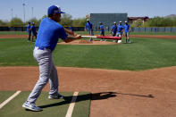 Israel Olympic Baseball team assistant coach Nate Mulberg hits grounders to pitchers during practice at Salt River Fields, Wednesday, May 12, 2021, in Scottsdale, Ariz. Israel has qualified for the six-team baseball tournament at the Tokyo Olympic games which will be its first appearance at the Olympics in any team sport since 1976. (AP Photo/Matt York)