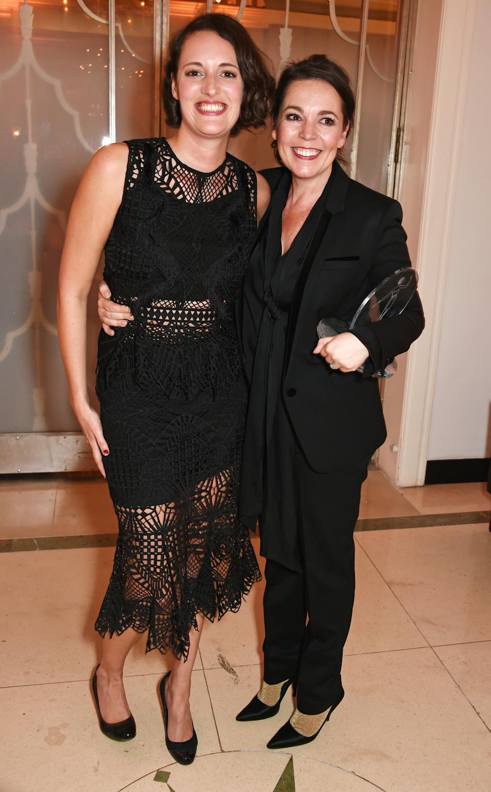 LONDON, ENGLAND - OCTOBER 31:  Presenter Phoebe Waller-Bridge (L) and Outstanding Performance award winner Olivia Colman attends the Harper's Bazaar Women of the Year Awards 2016 at Claridge's Hotel on October 31, 2016 in London, England.  (Photo by David M. Benett/Dave Benett/Getty Images for Harper's Bazaar)