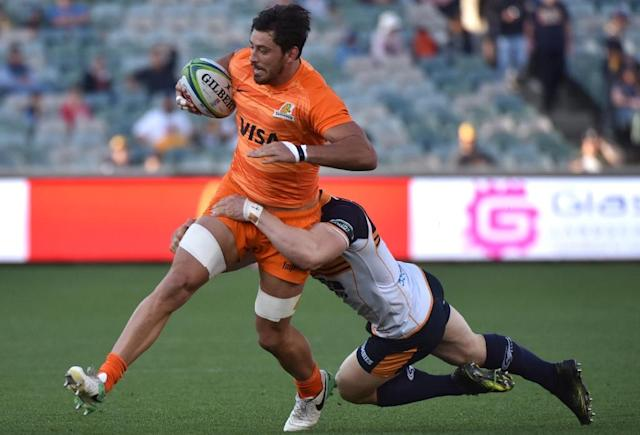 Jaguares' Ramiro Moyano (L) is tackled by Brumbies' Scott Sio (R) during the Super Rugby match (AFP Photo/Mark GRAHAM)