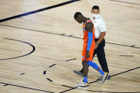 Oklahoma City Thunder's Dennis Schroder leaves the court after being ejected during the second half of an NBA basketball first round playoff game against the Houston Rockets Saturday, Aug. 29, 2020, in Lake Buena Vista, Fla. (AP Photo/Ashley Landis)