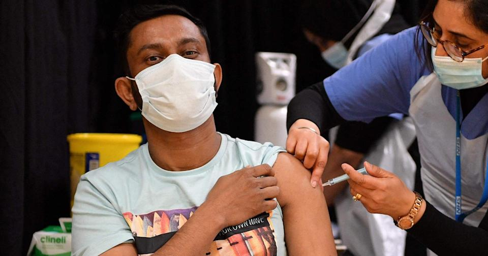 <p>A health worker gives an injection of the Astrazeneca/Oxford Covid-19 vaccine at a temporary vaccination centre set up at the East London Mosque</p> (AFP via Getty Images)