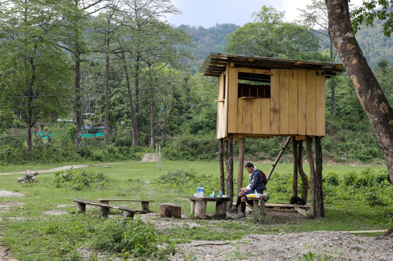 Bhutan's King Jigme Khesar Namgyel Wangchuck takes his lunch at a security outpost during his visit to remote villages to oversee measures to contain the spread of the coronavirus disease (COVID-19), in Tempaling