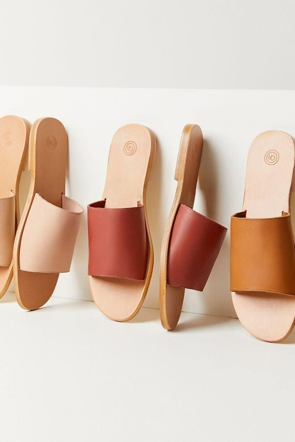 """<p>You can't go wrong with these <a href=""""https://www.popsugar.com/buy/UO%20Soft%20Leather%20Slide%20Sandals-427990?p_name=UO%20Soft%20Leather%20Slide%20Sandals&retailer=urbanoutfitters.com&price=29&evar1=fab%3Aus&evar9=43757690&evar98=https%3A%2F%2Fwww.popsugar.com%2Ffashion%2Fphoto-gallery%2F43757690%2Fimage%2F46340039%2FUO-Soft-Leather-Slide-Sandals&list1=shopping%2Cnordstrom%2Csandals%2Cshoes%2Csummer%2Csummer%20fashion%2Csummer%20shoes&prop13=mobile&pdata=1"""" rel=""""nofollow"""" data-shoppable-link=""""1"""" target=""""_blank"""">UO Soft Leather Slide Sandals</a> ($29, originally $39).</p>"""