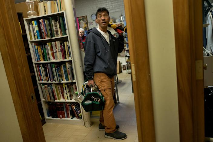 Harry Pangemanan took on the job as repairman for the church. (Photo: Alan Chin for Yahoo News)