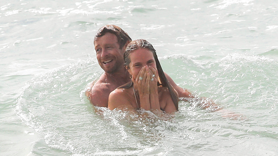 Simon Baker and new girlfriend Laura May Gibbs pictured in Byron Bay