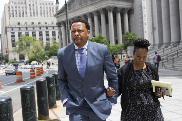 FILE - In this June 7, 2019, file photo, former Oklahoma State assistant basketball coach Lamont Evans leaves Federal Court in New York. An NCAA infractions committee panel announced Friday, June 5 2020, that former Oklahoma State assistant men's basketball coach Lamont Evans violated ethical-conduct rules by accepting up to $22,000 in bribes from financial advisers. (AP Photo/Kevin Hagen, File)