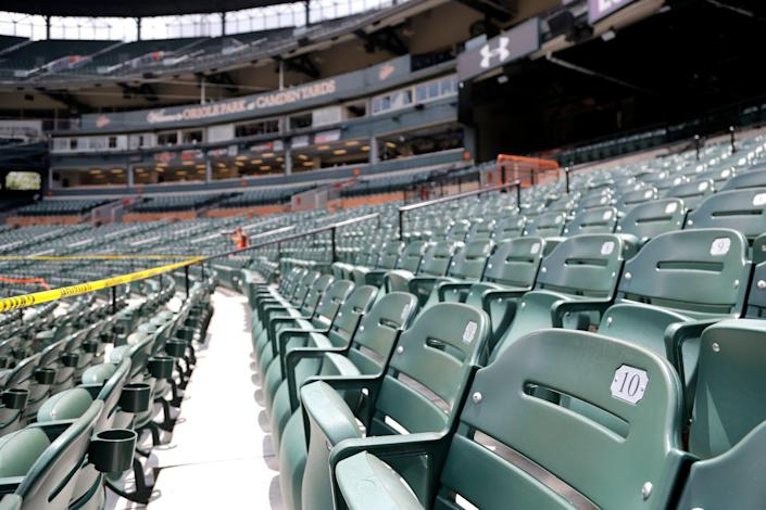 Empty seats during a baseball game between the Baltimore Orioles and the Tampa Bay Rays on Aug. 2, 2020, in Baltimore.