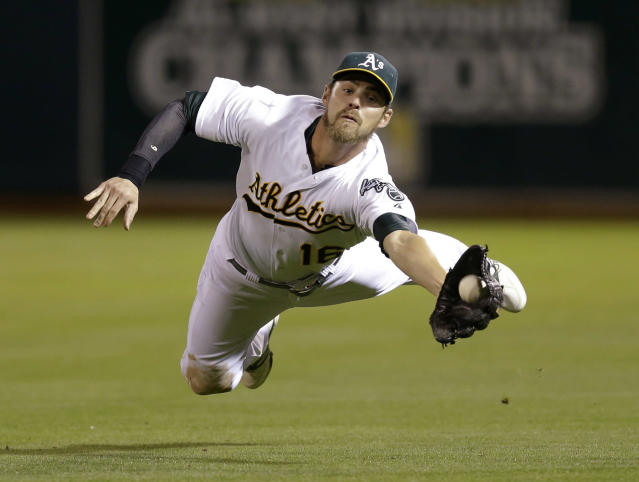 Oakland Athletics right fielder Josh Reddick makes the catch on a ball hit Tampa Bay Rays' Evan Longoria, before losing it when he made contact with the field in the fifth inning of a baseball game Tuesday, Aug. 5, 2014, in Oakland, Calif. Longoria singled on the play. (AP Photo/Ben Margot)