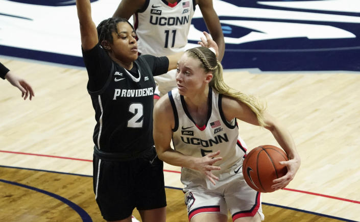 Connecticut guard Paige Bueckers (5) drives the ball against Providence guard Chanell Williams (2) during the first half of an NCAA college basketball game at Harry A. Gampel Pavilion, Saturday, Jan. 9, 2021, in Storrs, Conn. (David Butler II/Pool Photo via AP)