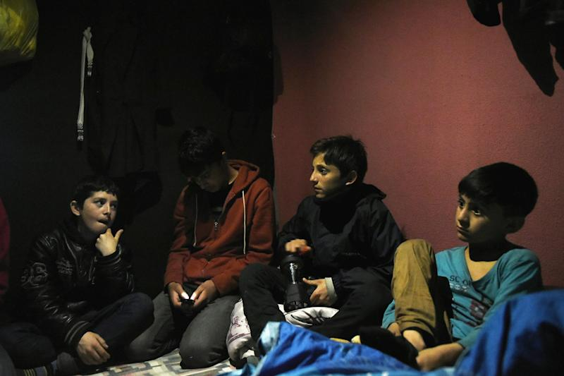 Children: Four young refugees from Afghanistan sit in a tent in The Jungle, Calais: Mary Turner/Getty Images