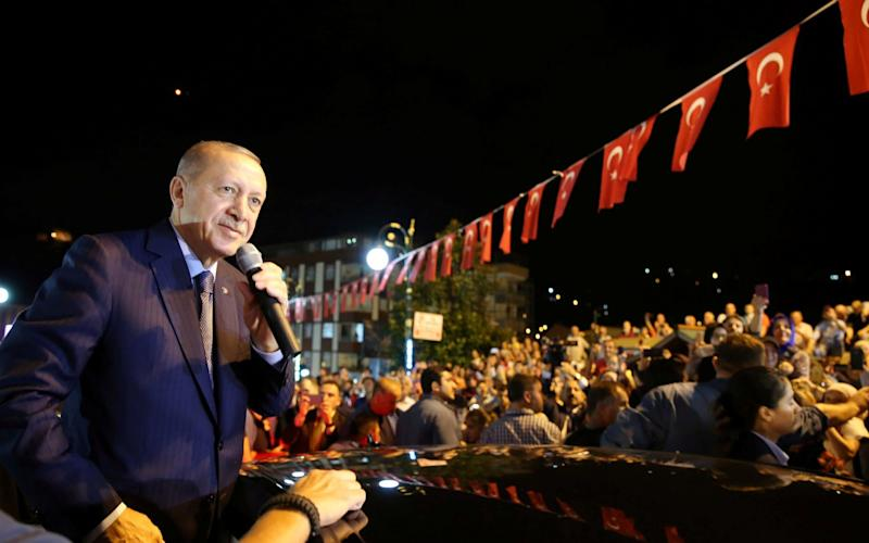 Turkish President Tayyip Erdogan has told Turks not to worry about the nosedive in the value of their country's currency, saying: 'If they have their dollars, we have our people, our God' - REUTERS