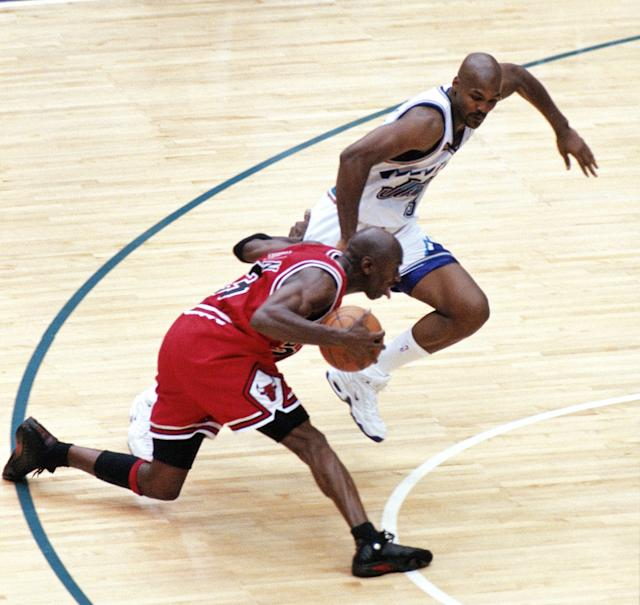 Michael Jordan places his hand on Bryon Russell's hip before his iconic jump shot to win the 1998 NBA Finals. (Getty Images)