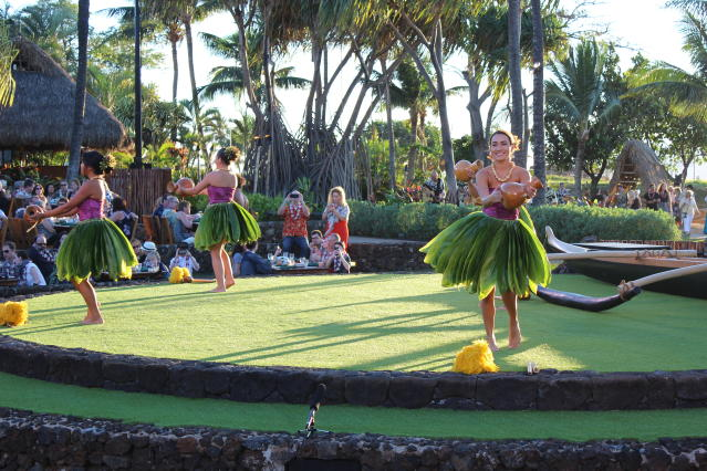 Hula dancers tell their stories through graceful moves at a traditional hula and feast, the Old Lahaina Luau, in Maui. (AP Photo/Jennifer McDermott)