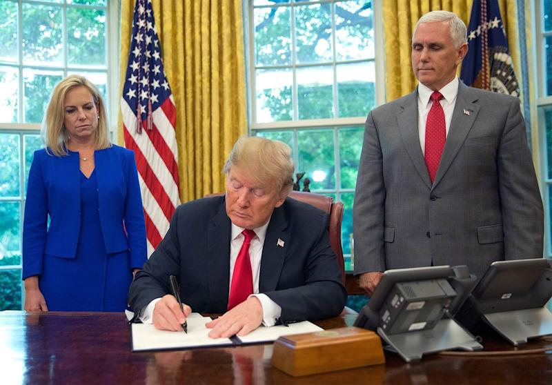 Kirstjen Nielsen, Donald Trump, and Mike Pence