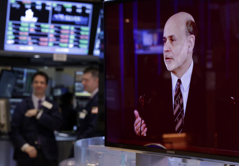A television screen on the floor of the New York Stock Exchange shows the news conference of Federal Reserve Chairman Ben Bernanke, Wednesday, March 20, 2013. In a statement after a two-day meeting, the Fed stood by its plan to keep short-term rates at record lows at least until unemployment falls to 6.5 percent, as long as the inflation outlook remains mild. (AP Photo/Richard Drew)