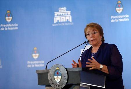 Chile's President Bachelet speaks during a news conference alongside Argentine President Macri in Buenos Aires