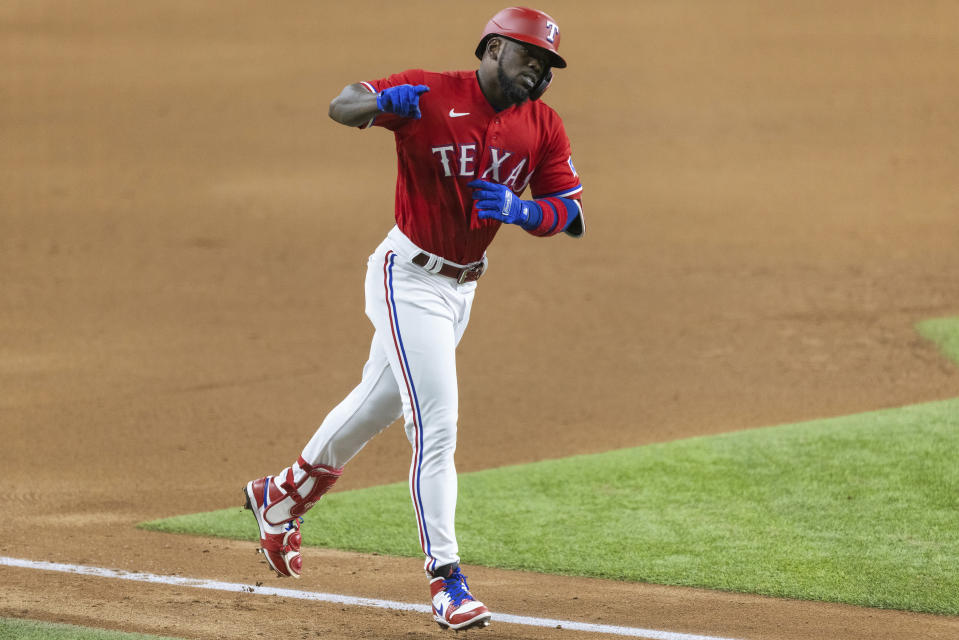 Texas Rangers' Adolis Garcia runs the bases after hitting a solo home run during the seventh inning of a baseball game against the Minnesota Twins in Arlington, Texas, Friday, June 18, 2021. (AP Photo/Andy Jacobsohn)