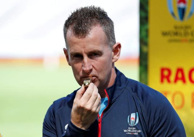 FILE PHOTO: Referee Nigel Owen holds up the whistle to be used in the opening match of the Rugby World Cup, in Tokyo