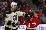 Boston Bruins defenseman Zdeno Chara (33) pushes Detroit Red Wings left wing Adam Erne (73) during the second period of an NHL hockey game, Friday, Nov. 8, 2019, in Detroit. (AP Photo/Carlos Osorio)
