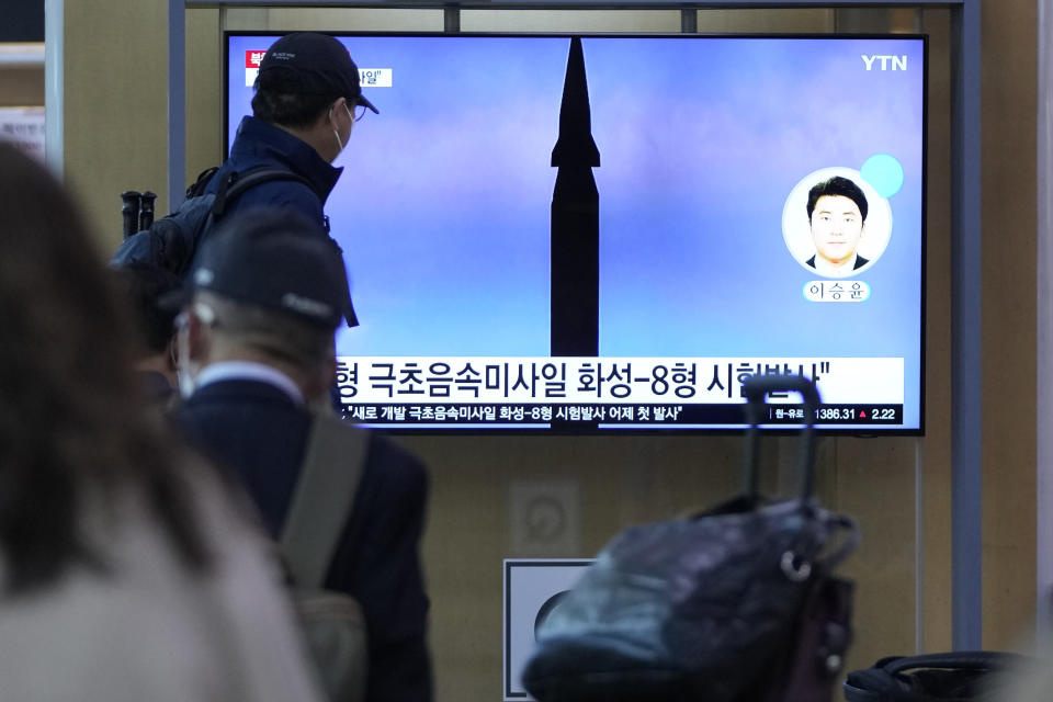 """People watch a TV screen showing a news program reporting about North Korea's missile launch at a train station in Seoul, South Korea, Wednesday, Sept. 29, 2021. North Korea said Wednesday it successfully tested a new hypersonic missile it implied was being developed as nuclear capable, as it continues to expand its military capabilities and pressure Washington and Seoul over long-stalled negotiations over its nuclear weapons. The Korean letters read: """"Test a new hypersonic missile."""" (AP Photo/Lee Jin-man)"""