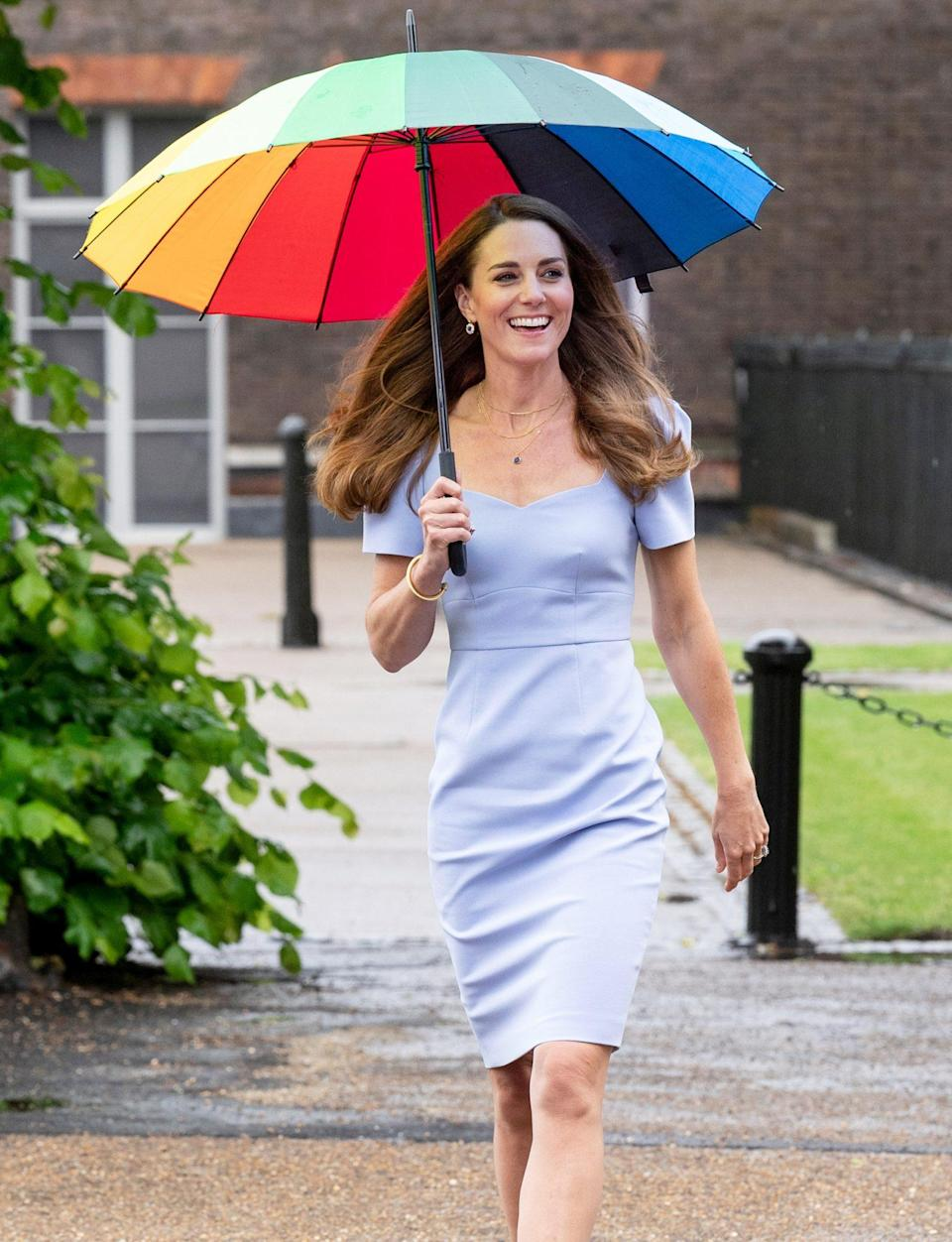 """<p>Rainbow in the storm! Kate Middleton brightens up a dreary June 18 with a colorful umbrella while reuniting in London with parents she has met during her decade-long journey culminating in the launch of the groundbreaking <a href=""""https://people.com/royals/kate-middleton-royal-foundation-centre-for-early-childhood-launch/"""" rel=""""nofollow noopener"""" target=""""_blank"""" data-ylk=""""slk:Royal Foundation Centre for Early Childhood"""" class=""""link rapid-noclick-resp"""">Royal Foundation Centre for Early Childhood</a>.</p>"""