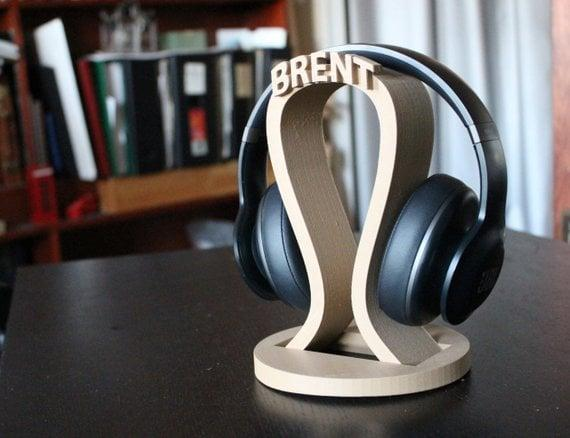 """<p>This <a href=""""https://www.popsugar.com/buy/Personalized-Headphone-Stand-395383?p_name=Personalized%20Headphone%20Stand&retailer=etsy.com&pid=395383&price=36&evar1=geek%3Aus&evar9=36026397&evar98=https%3A%2F%2Fwww.popsugar.com%2Ftech%2Fphoto-gallery%2F36026397%2Fimage%2F45606042%2FPersonalized-Headphone-Stand&list1=gifts%2Cgadgets%2Choliday%2Cgift%20guide%2Cdigital%20life%2Ctech%20gifts%2Cgifts%20for%20men&prop13=mobile&pdata=1"""" class=""""link rapid-noclick-resp"""" rel=""""nofollow noopener"""" target=""""_blank"""" data-ylk=""""slk:Personalized Headphone Stand"""">Personalized Headphone Stand</a> ($36) is perfect for every music-lover.</p>"""