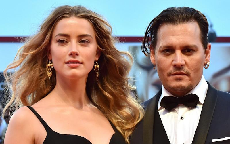Johnny Depp and Amber Heard -  GIUSEPPE CACACE/AFP via Getty Images
