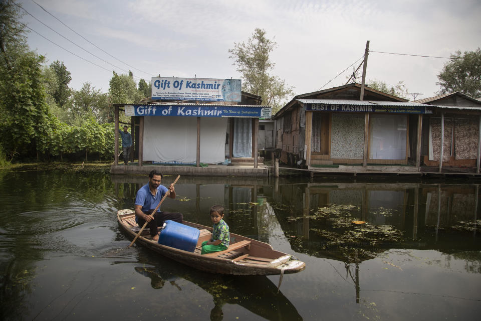 A Kashmiri boatman rows his boat through a closed floating market on the Dal Lake during lockdown to stop the spread of the coronavirus in Srinagar, Indian controlled Kashmir, July 17, 2020. Indian-controlled Kashmir's economy is yet to recover from a colossal loss a year after New Delhi scrapped the disputed region's autonomous status and divided it into two federally governed territories. (AP Photo/Mukhtar Khan)