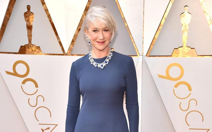 Helen Mirren, 73, does 12 minutes of exercises each day which include hopping one one leg and arm circles - Kevin Mazur