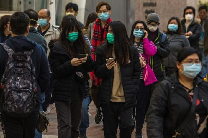 As a city that lost nearly 300 people to the SARS virus in 2003, Hong Kongers are taking few chances over the latest disease outbreak that began in central China and has since spread (AFP Photo/DALE DE LA REY)
