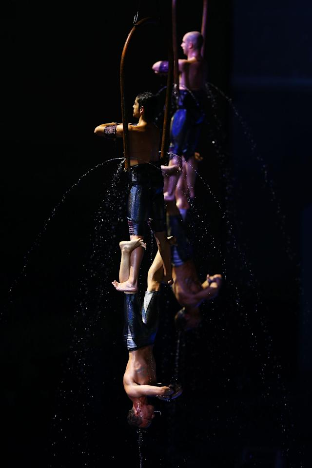 BARCELONA, SPAIN - JULY 19: Acrobats perform during the Opening Ceremony of the 15th FINA World Championships at Palau Sant Jordi on July 19, 2013 in Barcelona, Spain. (Photo by Al Bello/Getty Images)