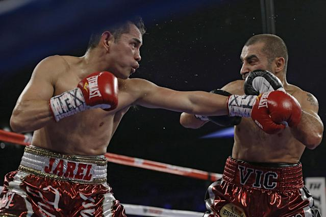 Nonito Donaire, left, lands a punch on Vic Darchinyan during round 4 of their featherweight rematch, Saturday, Nov. 9, 2013, in Corpus Christi, Texas. (AP Photo/Eric Gay)