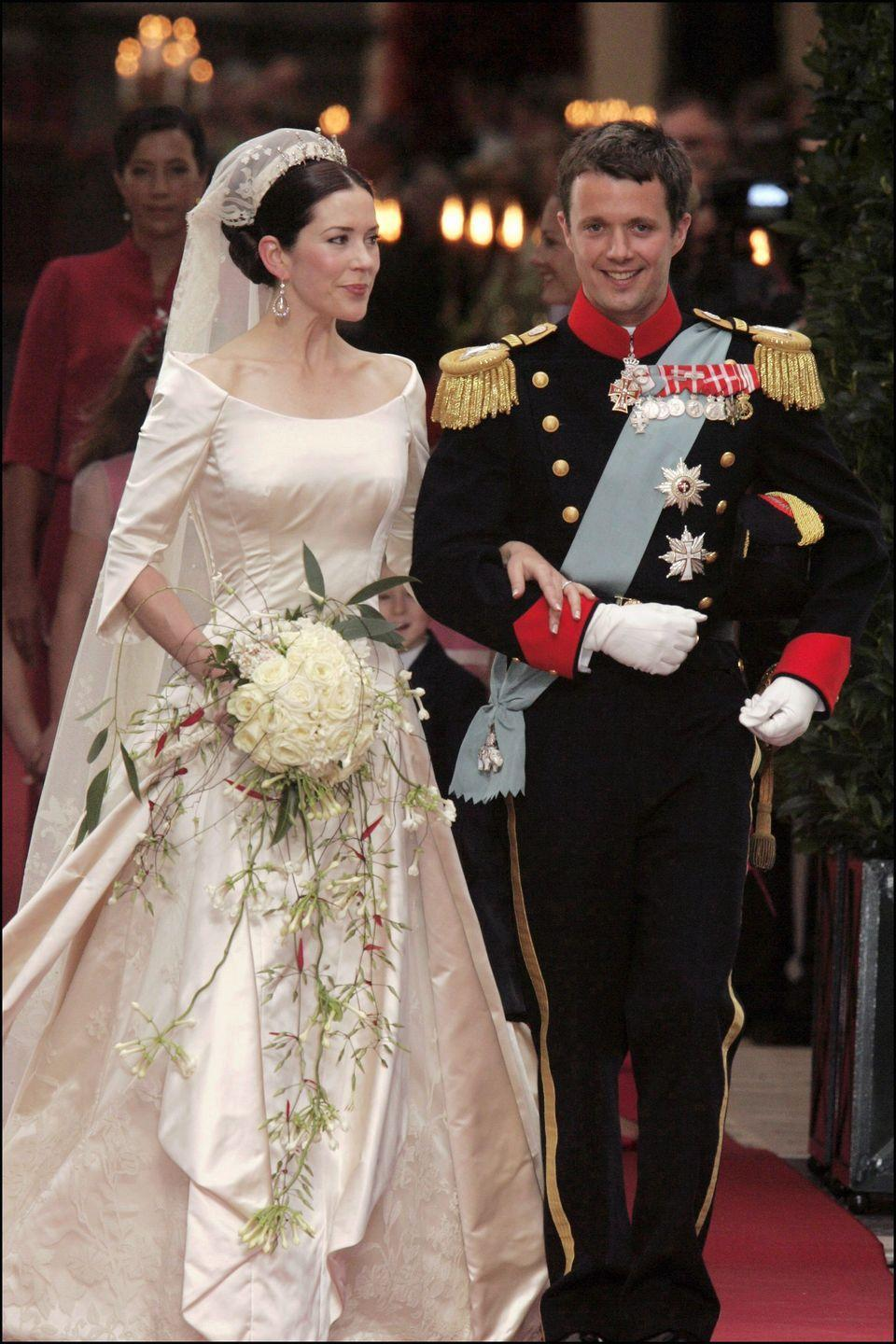"<p>Mary Donaldson of Denmark married Crown Prince Frederik on May 14, 2004 at the <span class=""redactor-unlink"">Church of Our Lady in Copenhagen, Denmark</span>. Donaldson's wedding dress, created by Danish designer Uffe Frank, was made of an ivory duchess satin with a scoop neckline, a slim-fit bodice and lily-like sleeves. </p>"
