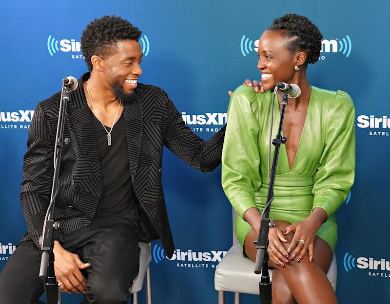 NEW YORK, NY - FEBRUARY 13: Chadwick Boseman and Lupita Nyong'o take part in SiriusXM's Town Hall with the cast of Black Panther hosted by SiriusXM's Sway Calloway on February 13, 2018 in New York City. (Photo by Cindy Ord/Getty Images for SiriusXM)