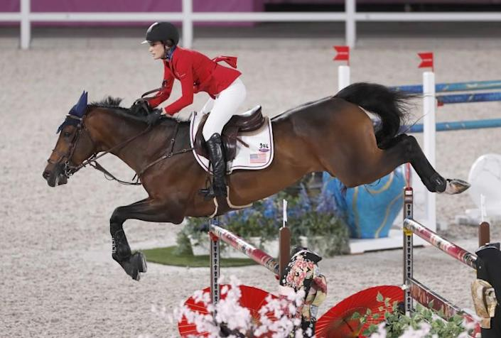 TOKYO, - AUGUST 03: Jessica Springsteen riding her horse Don Juan Van De Donkhoeve clears a gate during the Jumping Individual Qualifier event at Equestrian Park during the Tokyo Olympics. This is during the Tokyo Olympics.Tokyo Olympics on Tuesday, Aug. 3, 2021 in Tokyo, {stmens}. (Gary Ambrose / For the Times)