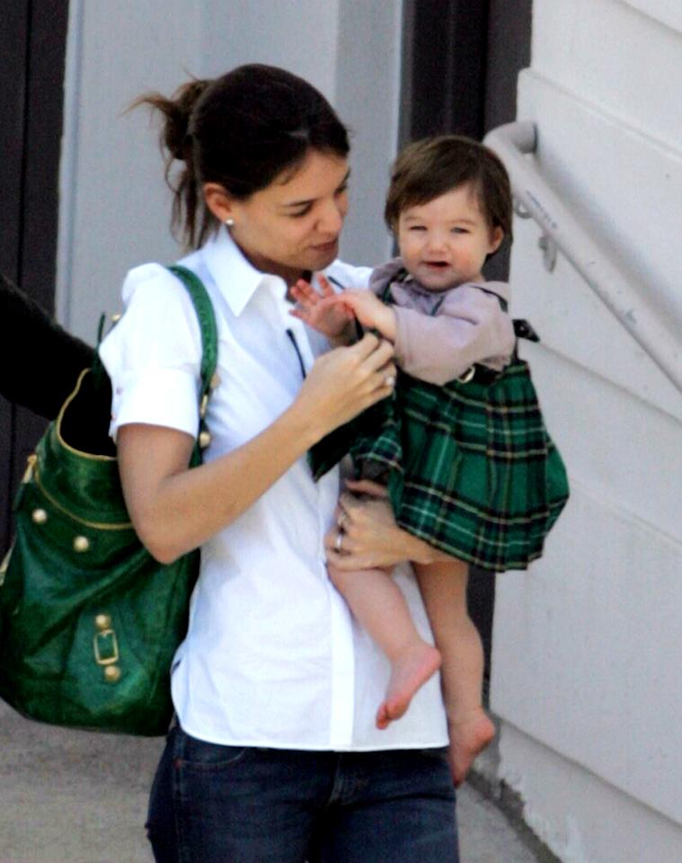 Suri avoided a playful pinch when she donned a green tartan-printed  jumper in honor of St. Patrick's Day in March 2007 in Beverly Hills.