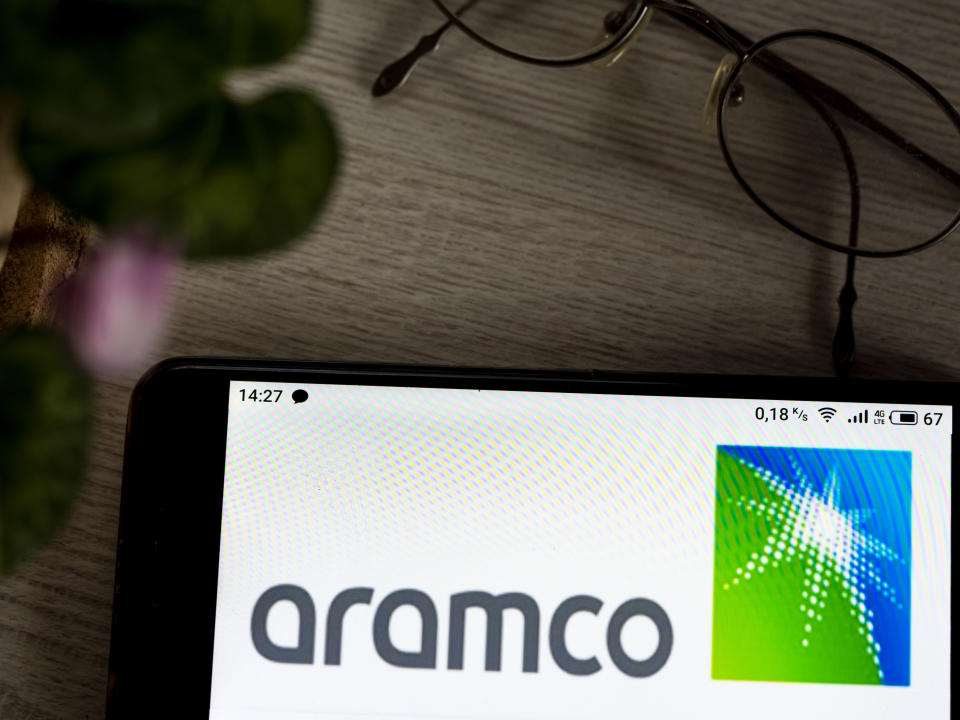 UKRAINE - 2020/11/08: In this photo illustration a Saudi Arabian Oil Company (Saudi Aramco) logo is seen displayed on a smartphone. (Photo Illustration by Valera Golovniov/SOPA Images/LightRocket via Getty Images)