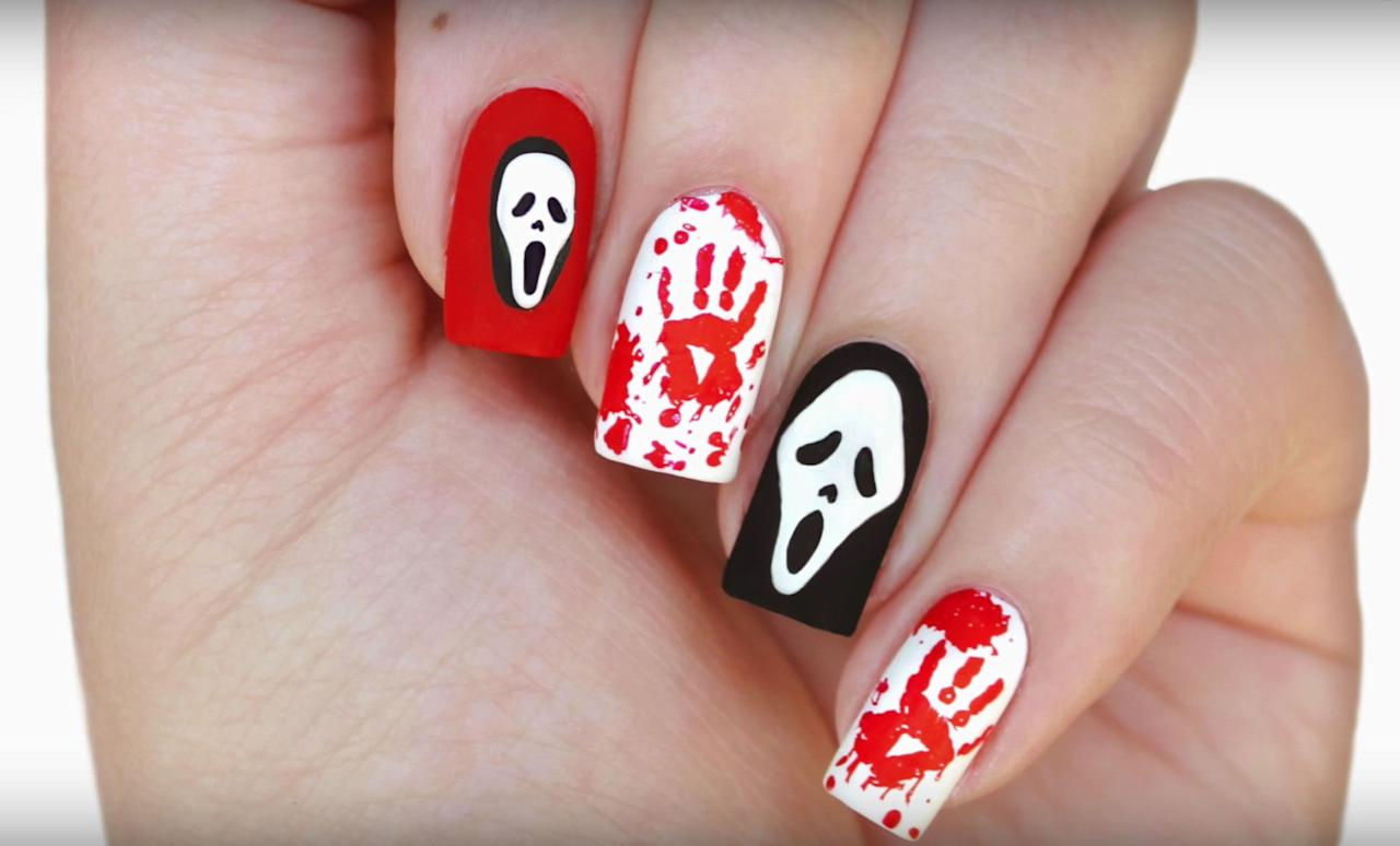 """<p>YouTube nail maven JauntyJuli came up with this creepy and yet somehow cute tribute to <em>Scream</em> and its signature scary costume, Ghostface.</p><p><em><a rel=""""nofollow"""" href=""""https://www.youtube.com/watch?v=uAkIT9ON1wI"""">Get the tutorial on YouTube »</a></em><span></span><br></p><p><strong>What you'll need: </strong><em>nail art brushes ($8; <a rel=""""nofollow"""" href=""""https://www.amazon.com/Winstonia-Professional-Striping-Blending-Elongated/dp/B00GD0IQQ6/ref=sr_1_3_a_it?tag=syndication-20"""">amazon.com</a>)</em></p>"""