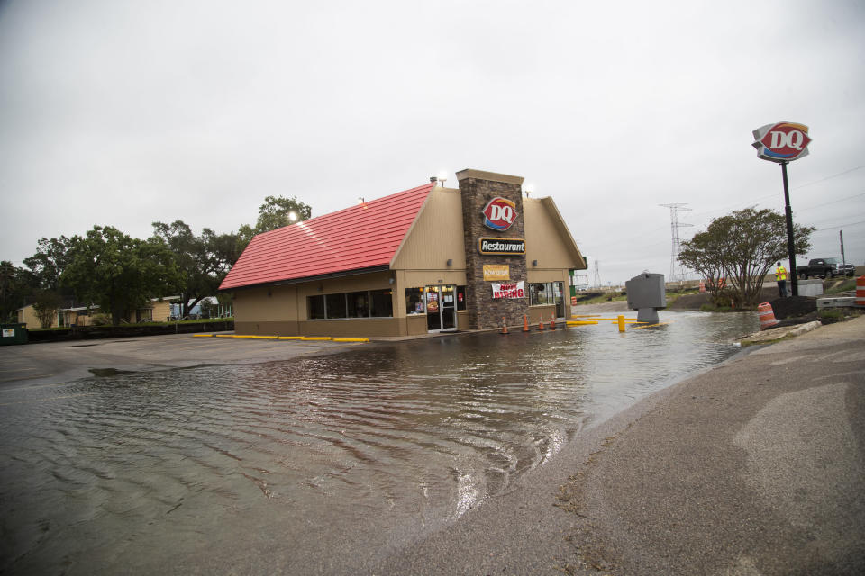 DQ Restaurant's parking area experiencing flooding ahead of Tropical Storm Beta Monday, Sept. 21, 2020 in Kemah, Texas. (Marie D. De Jesús/Houston Chronicle via AP)
