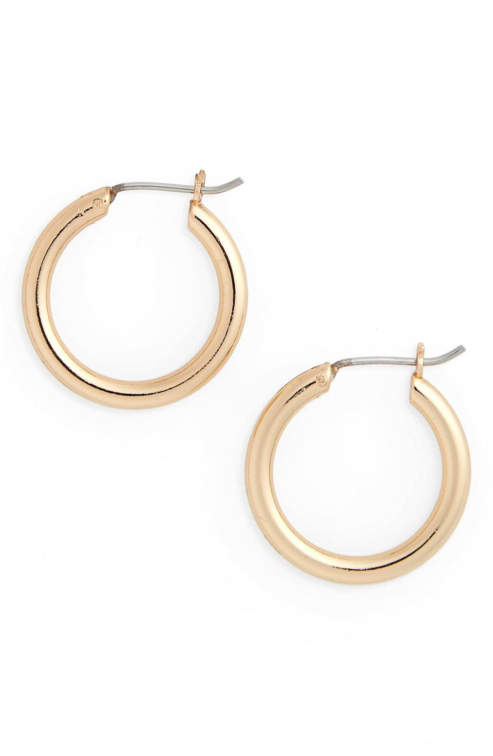 """<p>These <a href=""""https://www.popsugar.com/buy/Small-Endless-Hoop-Earrings-392705?p_name=Small%20Endless%20Hoop%20Earrings&retailer=shop.nordstrom.com&pid=392705&price=19&evar1=fab%3Aus&evar9=45535502&evar98=https%3A%2F%2Fwww.popsugar.com%2Ffashion%2Fphoto-gallery%2F45535502%2Fimage%2F45536096%2FSmall-Endless-Hoop-Earrings&list1=shopping%2Cgifts%2Choliday%2Cchristmas%2Cgift%20guide%2Cgifts%20under%20%2425%2Cfashion%20gifts%2Cgifts%20for%20women%2Cgifts%20under%20%2450%2Cgifts%20under%20%2475%2Caffordable%20shopping&prop13=mobile&pdata=1"""" class=""""link rapid-noclick-resp"""" rel=""""nofollow noopener"""" target=""""_blank"""" data-ylk=""""slk:Small Endless Hoop Earrings"""">Small Endless Hoop Earrings</a> ($19) go with everything.</p>"""